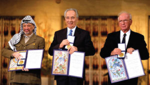 From let, Yasser Arafat, Shimon Peres and Yitzhak Rabin presenting their Nobel Peace Prize certificates in Oslo, Norway, 1994. (Photo: Israel Government Press Office).